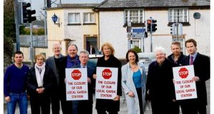 Stepaside residents and traders oppose the closure of the local Garda station. From left, Paolo Borza; Jean Dermody; Canon David Moynan; Frank Mulvey, Des Kennedy; Def Leppard singer Joe Elliott; Cllr Lettie McCarthy; peace commissioner Bob Gahan; John McCluskey; and Joseph Lee. photograph: cyril byrne