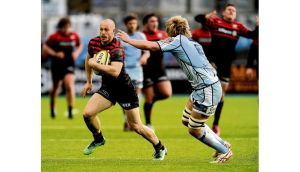 Run-out: Saracens' James Short (left) gets away from Cardiff Blues' Luke Hamilton at Allianz Park last weekend. PHOTOGRAPH: ANDREW MATTHEWS/PA WIRE