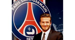 David Beckham arrives at a news conference in Paris yesterday to announce his five-month contract with French Ligue 1 club Paris St Germain. photograph: Reuters