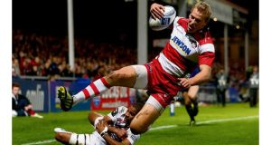 New England centre Billy Twelvetrees scoring a try for Gloucester during the Amlin Challenge Cup match against Bordeaux-Begles in October.