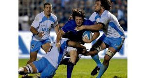 Maxime Machenaud (centre) is tackled by Argentinian Pumas' flanker Tomas De la Vega (left) and lock Esteban Lozada during the Test match at Jose Fierro stadium in Tucuman, Argentina, in June 2012. photograph: juan mabromata/getty