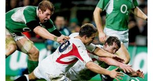 Josh Lewsey gets the ball away under pressure from Brian O'Driscoll in the Six Nations match between Ireland and England, at Croke Park in 2007. photograph: eric luke/the irish times