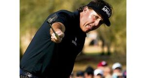 Phil Mickelson encourages his 59th shot to drop on his final hole during the first round of the Phoenix Open yesterday.