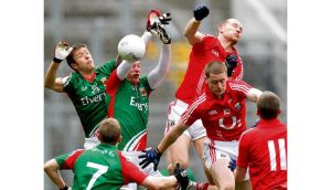Action from last year's Division One final between Mayo and Cork. In the past 25 years, only Cork in 2011 managed to add a league title to the previous year's All-Ireland. photograph: Inpho
