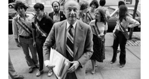 Edward I. Koch carries petitions supporting his candidacy for mayor of New York City, as he is followed by supporters into Board of Elections headquarters in July 1977. Photograph: Don Hogan Charles/The New York Times