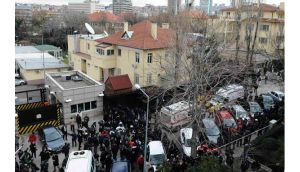 Riot police block a street after an explosion at the entrance of the US embassy in Ankara. Photograph: Reuters