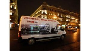 A minibus decorated with a portrait of Soviet dictator Josef Stalin drives on a street in St Petersburg. Photograph: Alexander Demianchuk/Reuters.