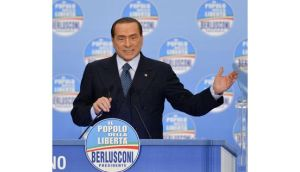 Italy's former prime minister Silvio Berlusconi waves during a political rally in Milan today. Photograph: Paolo Bona/Reuters.