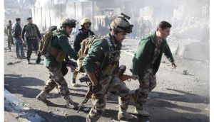 A wounded person is carried by soldiers at the site of a suicide bomb attack in Kirkuk today. Photograph: Ako Rasheed/Reuters.