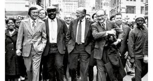 "Ed Koch walks with supporters down a New York street. "" He talked tough and ... he was tough."" photograph: new york times"
