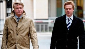 Brian O'Donnell and his son Blake leave the High Court in London yesterday where they attended a bankruptcy hearing. photograph: will oliver
