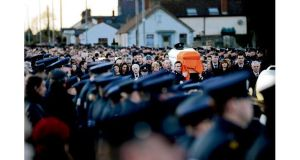 Public outpouring: the State funeral of Det Garda Adrian Donohoe this week. photographs: dara mac dónaill, peter muhly/afp/getty