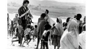Bob Geldof in Africa in 1985. photographs: manchester daily express/sspl/getty, terry thorp, georges dekeerle/getty and fin costello/redferns/getty