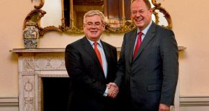 Tánaiste Eamon Gilmore shakes hands yesterday with former German minister Peer Steinbrück of the Social Democratic Party outside Iveagh House on St Stephen's Green, Dublin. A report by Notre Europe - Institut Delors, to mark the 40th anniversary of Ireland's EU accession, concludes the debt crisis has shifted Irish attitudes to European integration. photograph: brenda fitzsimons