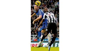 Newcastle's Mapou Yanga-Mbiwa and Gary Cahill of Chelsea battle for possession during Saturday's Premier League match at St James' Park. photograph: paul thomas/getty images