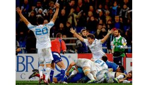 Italian players celebrate as referee Nigel Owens blows the whistle for full time in Rome yesterday. photograph: filippo monteforte/getty images