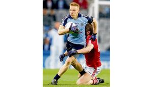 Dublin's Paddy Quinn is tackled by Andrew O'Sullivan of Cork during Saturday night's National League game at Croke Park. photograph: cathal noonan/inpho