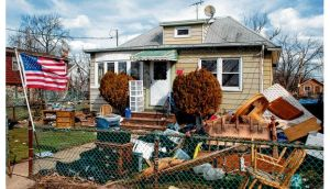 A house damaged by Sandy in Staten Island. photographs: barry cregg, new york times