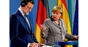 Angela Merkel and Mariano Rajoy address a news conference after talks in Berlin yesterday. Photograph: Reuters