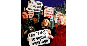 Campaigners demonstrate for a Yes vote to allow gay marriage outside Westminster in London yesterday. Photograph: Luke MacGregor/Reuters