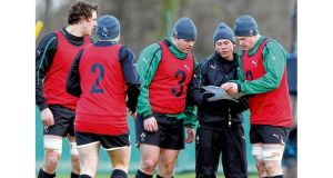 Mike McCarthy, Rory Best, Mike Ross, Les Kiss and Jamie Heaslip consult during Ireland's training session at Carton House yesterday. Photograph: Dan Sheridan