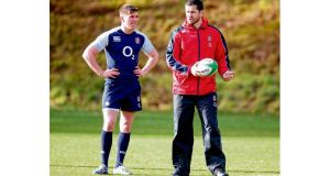 Owen Farrell, left, has learned from the best, in the form of his dad Andy, right, a former rugby league and union star and a member of England's coaching staff