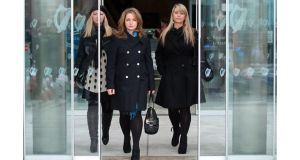 Diane Begley (middle) wife of businessman Paul Begley with her sisters Claire (Left) and Michelle (Right) leaving court today. Photograph: Collins Courts