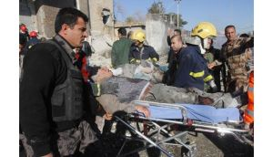 Medical personnel carry victims on stretchers at the site of a suicide bomb in Kirkuk yesterday. Photograph: Ako Rasheed/Reuters