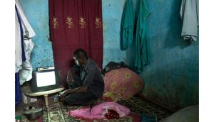 A man watches television, which was restricted under Islamist rule, in Timbuktu, Mali. Photograph: Tyler Hicks/The New York Times