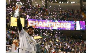 Baltimore Ravens inside linebacker Ray Lewis hoists the Vince Lombardi Trophy. Photograph: Jeff Haynes/Reuters