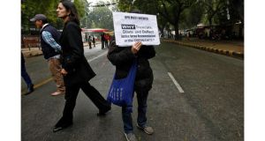 A demonstrator holds a placard during a protest against United Progressive Alliance (UPA) government in New Delhi yesterday.  The protesters demanded harsher punishments and quicker trials for rape. Photograph: Mansi Thapliyal/Reuters