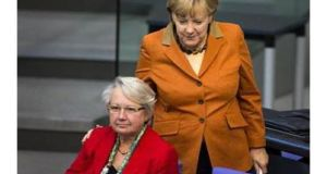 Angela Merkel's education minister Annette Schavan (left) said today she would take legal action against a decision to void her doctorate for alleged plagiarism. Photograph: Reuters