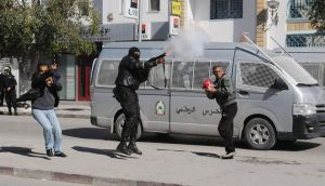 A police officer fires teargas to break up a protest during a  demonstration in Gafsa yesterday.  Thousands of Tunisians demonstrated outside the interior ministry headquarters. Photograph: Reuters/stringer