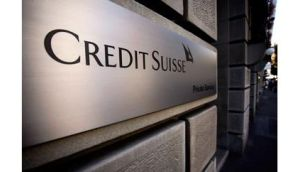 Credit Suisse reported a fourth-quarter profit that missed estimates as it booked reorganisation costs and a charge related to its own debt.