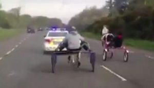 Two men were filmed racing each other on akies which consist of two wheels and a seat, held together by metal rods on the main Cork city to Mallow Road last Saturday morning. Photograph: Video still from YouTube/The Irish Times
