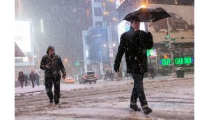 People making their way through heavy snow in New York last night. Blizzards have hit the north-eastern US snarling traffic, disrupting thousands of flights and prompting five governors to declare states of emergency