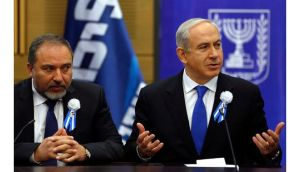 Israel's prime minister Benjamin Netanyahu (right) and former foreign minister Avigdor Lieberman attend a Likud-Beitenu faction meeting at parliament in Jerusalem. Photograph: Baz Ratner/Reuters