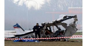A police photographer inspects the scene of a tourist plane crash at Charleroi airport. Photograph: Sebastien Pirlet/Reuters