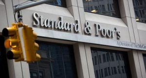 The Standard and Poor's logo is displayed at the company's headquarters in New York. The ratings agency is the first to improve their outlook on Irish debt since last week?s deal with the European Central Bank. Photograph: Scott Eells/Bloomberg