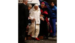 Pope Benedict XVI is helped as he arrives for a meeting at the Romano Maggiore seminary in Rome last week. The pontiff will step down as head of the Catholic Church on February 28th, the Vatican has confirmed. Photograph: Tony Gentile/Reuters