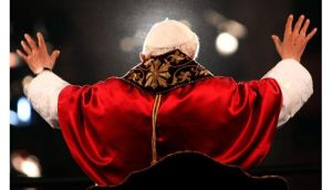 Pope Benedict XVI waves to the faithful gathered at the Colosseum in Rome during the Way Of The Cross procession on Good Friday last year. He announced today he was stepping down at the end of this month for health reasons. Photograph: Franco Origli