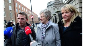 Steven O'Riordan, head of Magdalene Survivors Together, with Magdalene survivors Marina Gambold (centre) and Maureen Sullivan (right) speak to the media outside Leinster House on Monday afternoon. Photograph: Bryan O'Brien/The Irish Times