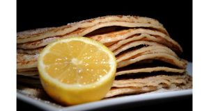 Pancakes with sugar and lemon, which are traditionally made on Shrove Tuesday to use up any remaining milk, eggs and butter before Lent begins tomorrow. Photograph: Joe Giddens/PA Wire