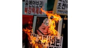 Protesters burn a portrait of North Korean leader Kim Jong-un during a rally today against North Korea's latest nuclear test near the US embassy in central Seoul. Photograph: Kim Hong-Ji/Reuters