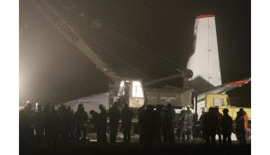A worker operates a crane near the damaged Antonov 24 turboprop plane near the airport in Donetsk. Photograph: Reuters