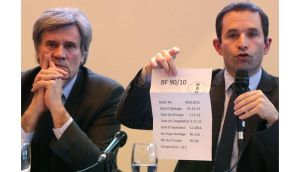 French minister Benoit Hamon holds a meat packing information sheet during a news conference with minister Stephane Le Foll. Supplier Spanghero knowingly sold horsemeat labelled as beef, according to the government. Photograph:Jacky Naegelen/Reuters