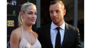 South African Olympian Oscar Pistorius and his girlfriend Reeva Steenkamp attend the Feather Awards in Johannesburg last November. Photograph: Lucky Nxumalo/City Press/Gallo Images/Getty Images