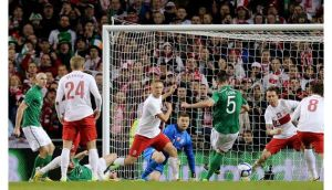 Ciaran Clark scores the opening goal against Poland at the Aviva Stadium. Photograph: James Crombie/Inpho