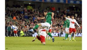 Wes Hoolahan scores the second goal against Poland. Photograph: Cathal Noonan/Inpho