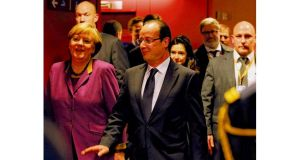 French president François Hollande and German chancellor Angela Merkel arrive to address the media after concluding an agreement on the budget for 2014-20. photograph: dan kitwood/getty images